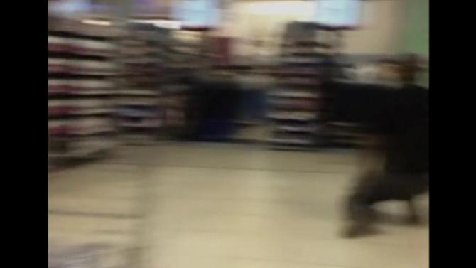 Amateur video shows distraught shoppers running for cover in Kenya