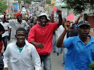 Haitians protest against the government and the cost of living on September 30, 2012 in Port-au-Prince. The demonstrators hold red cards demanding the departure of Haitian President Michel Martelly