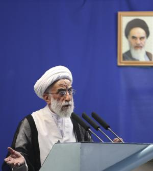 Hard-line Iranian cleric Ayatollah Ahmad Jannati, leader of the Guardian Council, delivers the Friday prayer's sermon, in front of a portrait of the late revolutionary founder Ayatollah Khomeini, at the Tehran University campus, in Tehran, Iran, Friday, May 13, 2011. (AP Photo/Vahid Salemi)