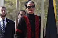 Qatar's First Lady Sheikha Mozah bint Nasser al-Missned attends a welcome ceremony upen her arrival at the Rafah border crossing with Egypt in the Gaza Strip. Qatar's emir called for Palestinian unity as he made a landmark visit to the Gaza Strip on Tuesday, the first to the enclave by a head of state since Hamas took over in 2007