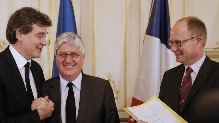 French Minister for Industrial Recovery Montebourg, French Ecology Sustainable Development and Energy Minister Martin and State Councillor Tuot attend the presentation of the reform of France's mining code at at the energy ministry in Paris