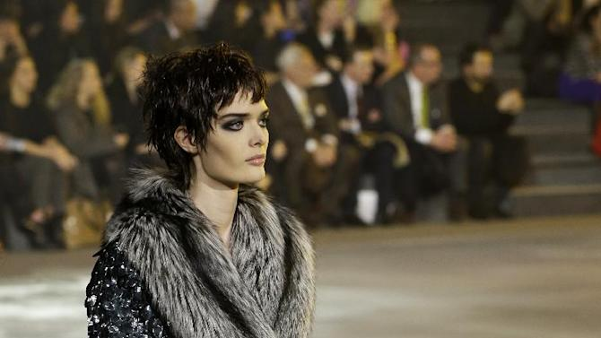 A model walks in a fur-collared coat during the Marc Jacobs Fall 2013 fashion show Fashion Week in New York, Thursday, Feb. 14, 2013.  (AP Photo/Kathy Willens)