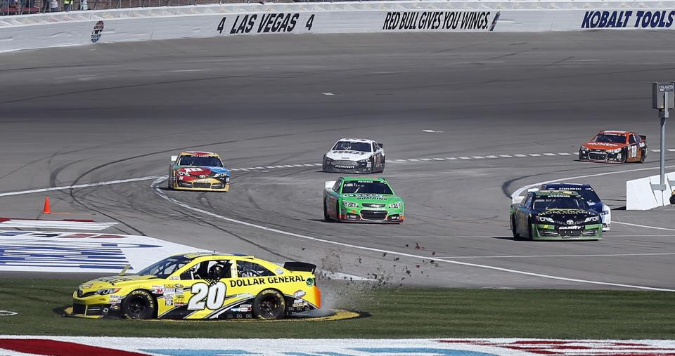 Driver Matt Kenseth (20) spins out across the infield after winning the NASCAR Sprint Cup Series auto race on Sunday, March 10, 2013, in Las Vegas. (AP Photo/Isaac Brekken)