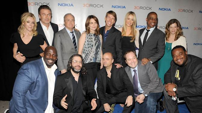 """The cast of '30 Rock' back row, from left, Jane Krakowski, Alec Baldwin, Lorne Michaels, Tina Fey, Jack McBrayer, Katrina Bowden,Keith Powell and front row, from left, Kevin Brown, Judah Friedlander, Scott Adsit, John Lutz and Grizz Chapman attend the Nokia """"30 Rock"""" wrap party on Thursday, Dec. 20, 2012 in New York. (Photo by Scott Gries for Nokia/AP Images)"""