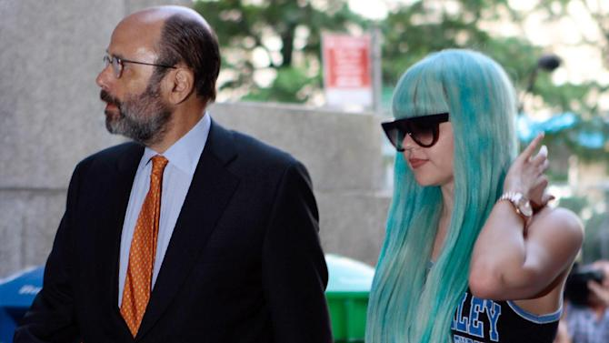 """FILE - In this Tuesday, July 9, 2013 file photo, Amanda Bynes, accompanied by attorney Gerald Shargel, arrives for a court appearance in New York on allegations that she chucked a marijuana bong out the window of her 36th-floor Manhattan apartment. A Manhattan judge on Friday, Jan. 10, 2014 ruled that the bong-toss case against Bynes will be dismissed if she stays out of trouble for six months and goes to counseling. The """"Hairspray"""" actress didn't appear in court. (AP Photo/Bethan McKernan, File)"""