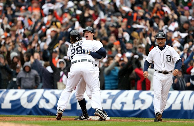 Don Kelly and Prince Fielder (28) celebrate the Tigers' win on Sunday. (Getty)