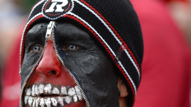 AP10ThingsToSee - Ottawa Redblacks fan Jimmy Fata wears face paint as he watches a CFL football game between the Redblacks and Saskatchewan Roughriders in Ottawa, Ontario, Canada on Sunday, Aug. 30, 2015. (Justin Tang/The Canadian Press via AP) MANDATORY CREDIT