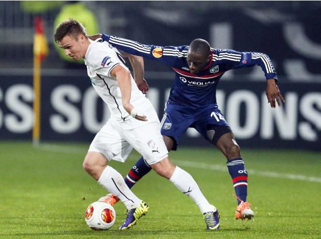 Olympique Lyon's Mouhamadou Dabo challenges Stanislav Tecl of Viktoria Plzen during their Europa League soccer match at the Gerland stadium in Lyon