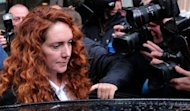"Ex-News International chief executive Rebekah Brooks leaves her lawyer's office on May 15. David Cameron received a text message from Brooks - one of Rupert Murdoch's closest aides - saying they were ""in this together"", Britain's press ethics inquiry heard during testimony from the prime minister"