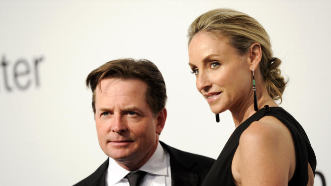 """Actors Michael J. Fox and Tracy Pollan attend """"Lincoln Center Presents: An Evening With Ralph Lauren"""" at Alice Tully Hall on Monday, Oct. 24, 2011 in New York. (AP Photo/Evan Agostini)"""