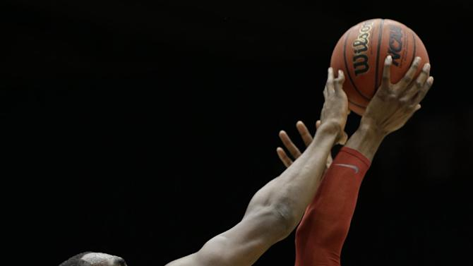 Iowa State forward Anthony Booker (22) and Ohio State forward Evan Ravenel (30) go for a rebound in the first half of a third-round game of the NCAA college basketball tournament Sunday  March 24, 2013, in Dayton, Ohio. (AP Photo/Al Behrman)
