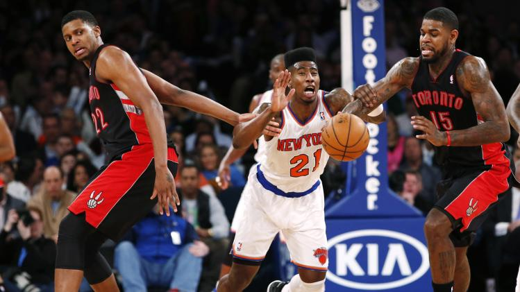 Toronto Raptors' Gay and Johnson battle New York Knicks' Shumpert for a loose ball in their NBA basketball game in New York