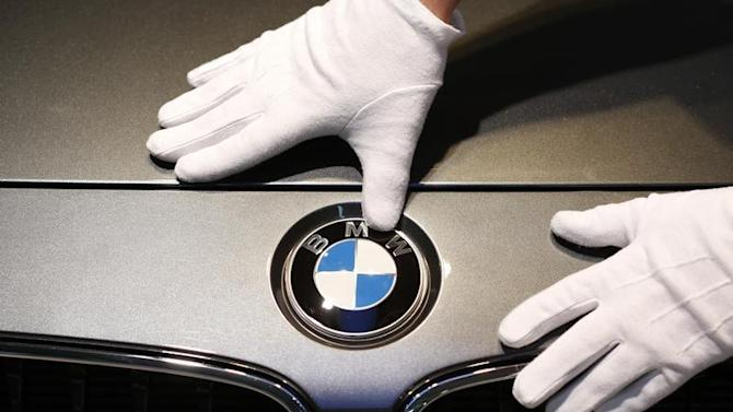 Man cleans BMW logo before news conference of German premium automaker BMW in Munich