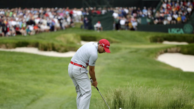 Sergio Garcia, of Spain, tees off on the 13th hole during the first round of the U.S. Open golf tournament at Merion Golf Club, Thursday, June 13, 2013, in Ardmore, Pa. (AP Photo/Charlie Riedel)
