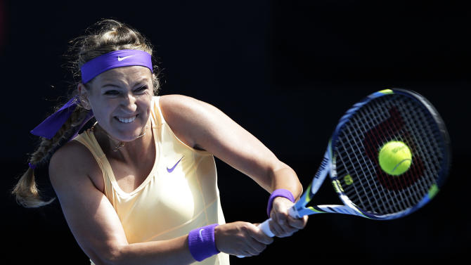 Victoria Azarenka of Belarus hits a return to Jamie Hampton of the US during their third round match at the Australian Open tennis championship in Melbourne, Australia, Saturday, Jan. 19, 2013. (AP Photo/Andy Wong)