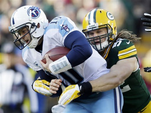 Rodgers, Packers rout Titans 55-7