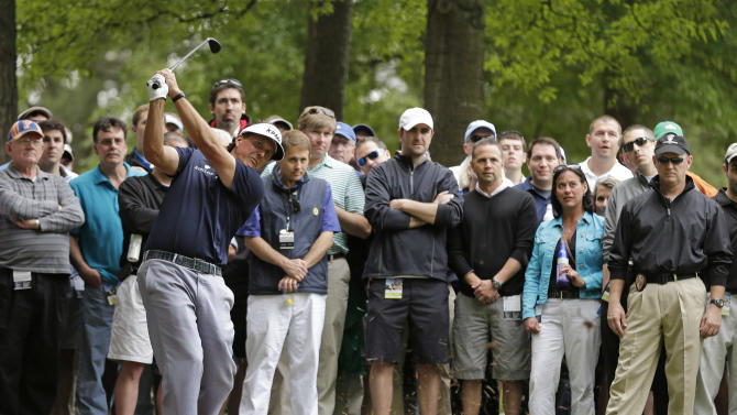 Phil Mickelson hits from the rough on the fifth hole during the second round of the Wells Fargo Championship golf tournament at Quail Hollow Club in Charlotte, N.C., Friday, May 3, 2013. (AP Photo/Chuck Burton)