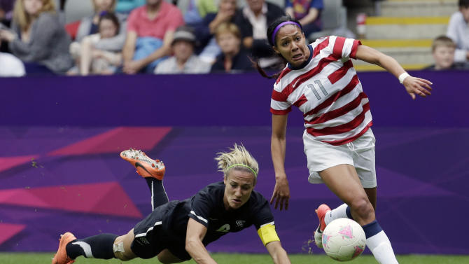 FILE - In this Aug. 3, 2012, file photo, United States' Sydney Leroux, right, passes by New Zealand's Rebecca Smith during a women's soccer match at the Summer Olympics at St. James' Park in Newcastle, England. Leroux says she was the object of a series of racist, sexist and xenophobic tweets in recent days and that her provocative celebration after her weekend goal against Canada was a response to the abuse. (AP Photo/Sergey Ponomarev, File)