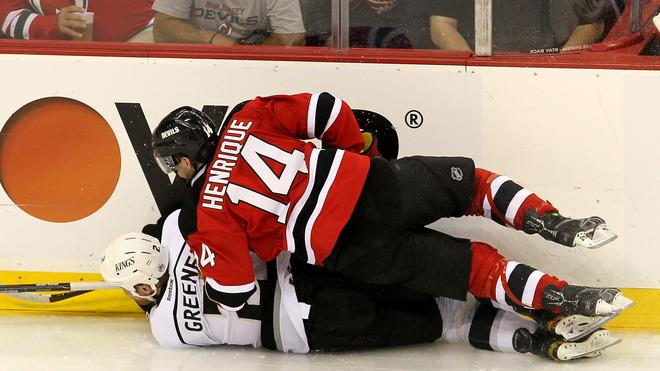 Matt Greene #2 Of The Los Angeles Kings And Adam Henrique #14 Of The New Jersey Devils Collide  Getty Images