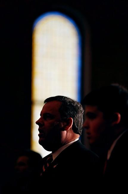 New Jersey Gov. Chris Christie is silhouetted as he attends a prayer service with his family in celebration of his inauguration at the New Hope Baptist Church on Tuesday, Jan. 21, 2014 in Newark. The