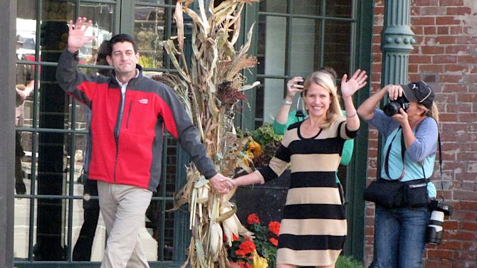 "Republican vice-presidential candidate Paul Ryan and his wife Janna, walk towards Elly's Tea and Coffee House Tuesday, Oct. 2, 2012, in Muscatine, Iowa. Ryan is on his ""Victory in Iowa"" bus tour. (AP Photo/Muscatine Journal, Joe Jarosz)"
