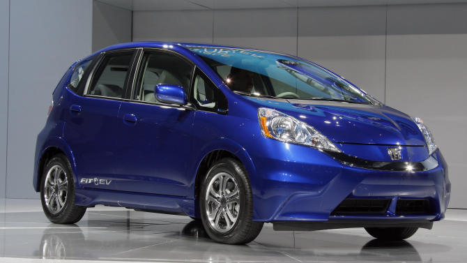 FILE -In this Nov. 16, 2011, file photo, the new all-electric 2013 Honda Fit EV is seen during its debut at the Los Angeles Auto Show, in Los Angeles.  Honda said Wednesday, June 6, 2012, that the 2013 Fit EV has received the highest fuel efficiency rating ever from the Environmental Protection Agency. (AP Photo/Reed Saxon, File)
