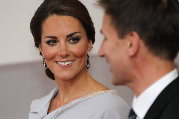 Kate, Duchess of Cambridge talks to Culture Secretary Jeremy Hunt as she leaves the Royal Academy of Arts in London after attending the UK creative industries reception hosted by the British Governmen