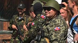 Armed separatists gather outside home of Ukraine's …