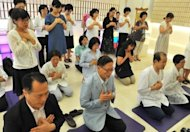 Unification Church followers hold a memorial service mourning the death of their leader Sun Myung Moon in the church&#39;s Seoul headquarters on September 3. While it claims a worldwide following of three million, experts suggest the core membership is far smaller