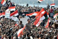 Egyptian protestors wave national flags and shout anti-government slogans during mass rally in the northern Mediterranean port of Alexandria in 2011 as protests continued in Egypt to demand the end of military rule. Egypt&#39;s ousted president Hosni Mubarak, now serving a life sentence over protester killings, said the authorities &quot;want to kill&quot; him in jail as his health deteriorated