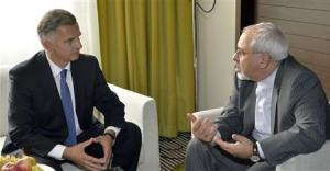 Swiss Foreign Minister Burkhalter talks to Iranian Foreign Minister Zarif during a private meeting in Geneva