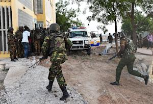 Kenyan Defence Forces run towards the Garissa University …