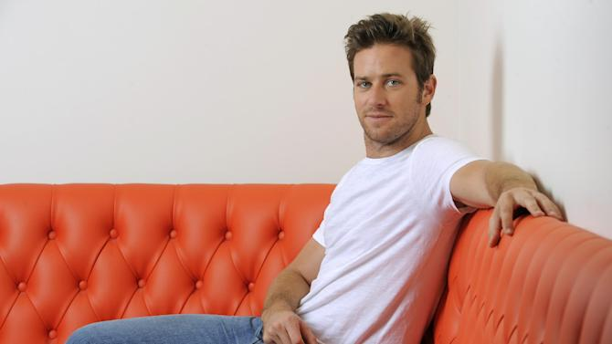 "In this Monday, June 10, 2013 photo, actor Armie Hammer poses for a portrait at the Pacific Design Center in West Hollywood, Calif. Hammer takes on his first major leading-man role opposite Johnny Depp in ""The Lone Ranger."" The movie releases July 3, 2013. (Photo by Chris Pizzello/Invision/AP)"