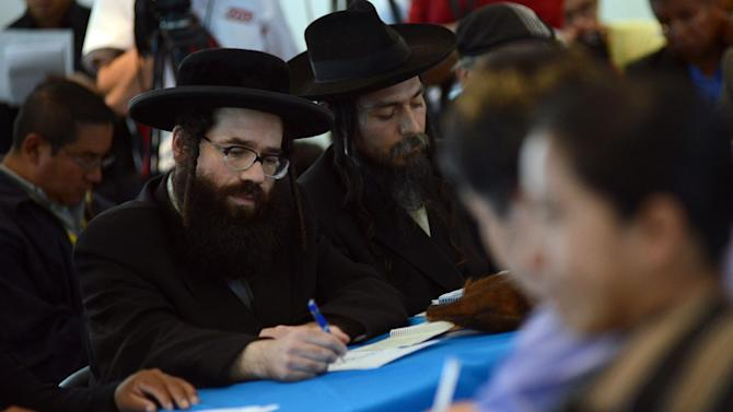 Members of the Orthodox Jewish community attend a meeting with leaders of San Juan La Laguna community at the headquarters of the Human Rights Office in Guatemala City, on August 27, 2014