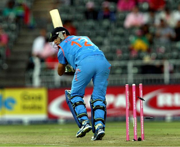 Indian cricketer Yuvraj Singh gets bowled during the 1st ODI match between India and South Africa at New Wanderers Stadium in Johannesburg on Dec.5, 2013. (Photo: IANS)