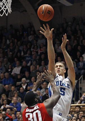 FILE - Duke's Mason Plumlee (5) shoots over Ohio State's Evan Ravenel (30) during the first half of an NCAA college basketball game in Durham, N.C., in this Nov. 28, 2012 file photo. As the college basketball season nears its midpoint, the player of year honor appears to be up for grabs with roughly two dozen players who could be considered the best in the country. Mason Plumlee is among a Pick 6 of players having outstanding seasons so far. (AP Photo/Gerry Broome, File)