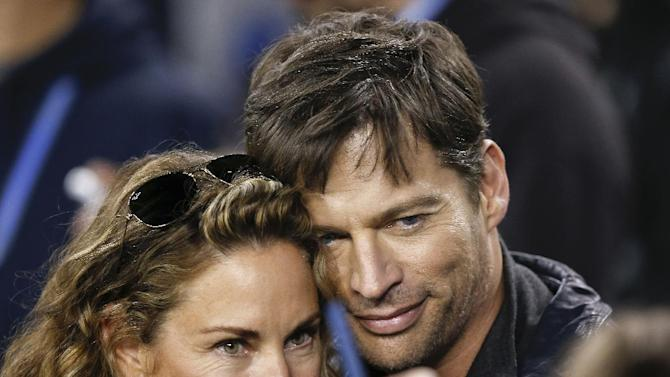 Harry Connick, Jr., right, poses for a picture with his wife, Jill Goodacre, before the NFL Super Bowl XLVIII football game Sunday, Feb. 2, 2014, in East Rutherford, N.J. (AP Photo/Kathy Willens)