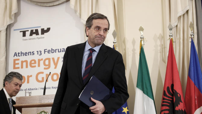 Greek Prime Minister Antonis Samaras leaves the podium after making a speech during a signing ceremony backing the privately-funded venture known as the Trans-Adriatic Pipeline, worth euro 1.5 billion ($2.02 billion), in Athens, on Wednesday, Feb. 13, 2013. Greece, Italy and Albania signed an agreement backing a proposed pipeline to transport natural gas from the Caspian Sea to western Europe. (AP Photo/Petros Giannakouris)
