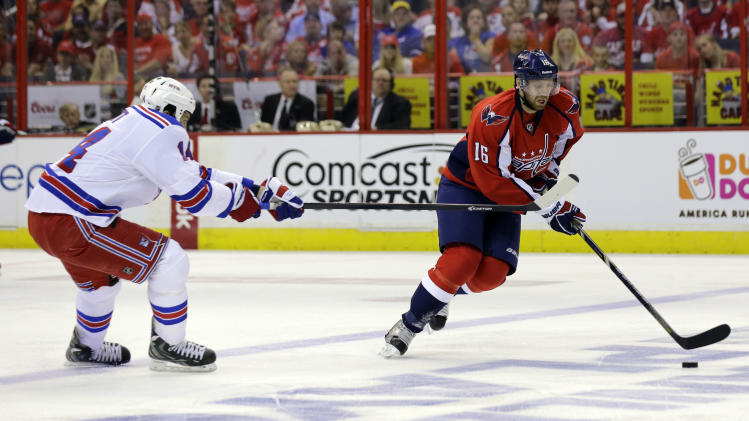 New York Rangers left wing Taylor Pyatt (14) reaches with his stick as Washington Capitals right wing Eric Fehr (16) skates with the puck in the first period of Game 5 first-round NHL Stanley Cup playoff hockey series, Friday, May 10, 2013, in Washington. (AP Photo/Alex Brandon)