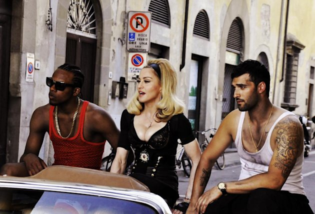 This undated image released by Guy Oseary shows pop star Madonna, center, during the filming of her music video for her new single, Turn Up The Radio, in Florence, Italy. The video will premiere on Vevo on Monday, July 16, 2012. (AP Photo/Guy Oseary)