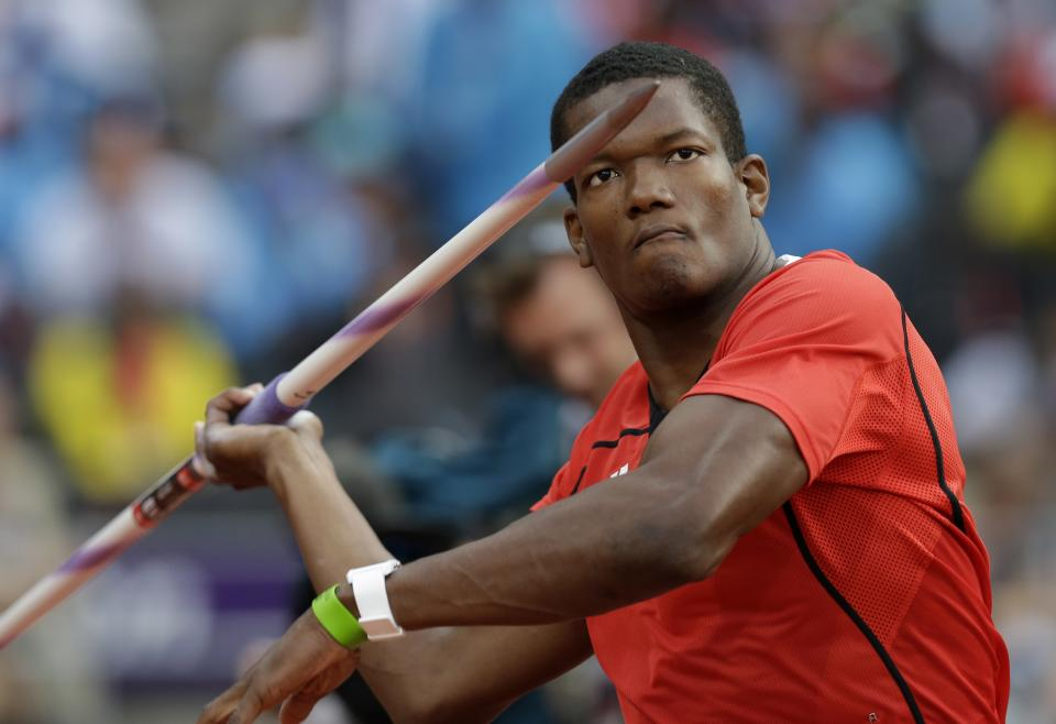 Trinidad's Keshorn Walcott takes a throw in the men's javelin throw final during the athletics in the Olympic Stadium at the 2012 Summer Olympics, London, Saturday, Aug. 11, 2012. Walcott went on to win the gold medal. (AP Photo/David J. Phillip )