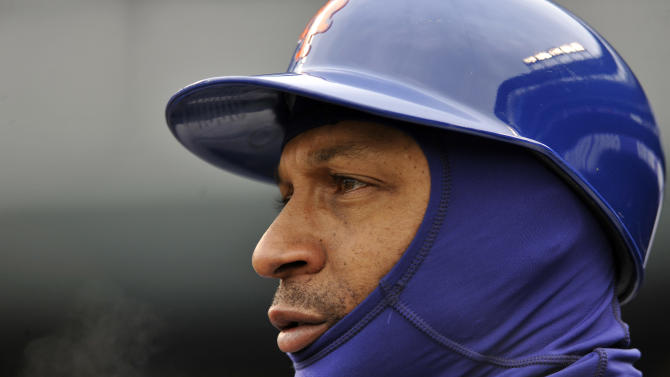 New York Mets' Tom Goodwin watches during the first inning in the first baseball game of a doubleheader on Tuesday, April 16, 2013, in Denver. (AP Photo/Jack Dempsey)