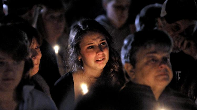 "A young woman cries during the candlelight vigil on Saturday night, Oct. 13, 2012, at the Bay State Commons, for Westboro's Elizabeth ""Lizzi"" Marriott, a University of New Hampshire student, who disappeared earlier in the week. Marriott is believed to be dead, and a man has been charged with second-degree murder.  (AP Photo/Steve Lanava, Worcester Telegram & Gazette)"