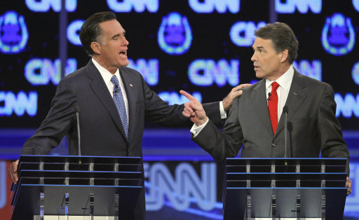 FILE - In this Oct. 18, 2011 file photo, Republican presidential candidates, former Massachusetts Gov. Mitt Romney, left, and Texas Gov. Rick Perry, speak during a Republican presidential debate in Las Vegas. Rick Perry plans to participate in at least five more presidential primary debates, his campaign said Saturday, Oct. 29, 2011 dismissing speculation that the Texas governor's lackluster performances so far would lead him to skip future Republican debates.  (AP Photo/Chris Carlson, File)
