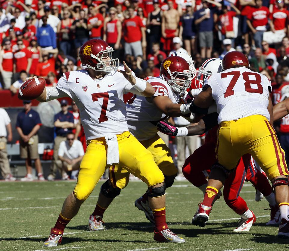 Southern California starting quarterback Matt Barkley (7) prepares to throw the ball against Arizona during the second half of an NCAA college football game at Arizona Stadium in Tucson, Ariz., Sat., Oct. 27, 2012. (AP Photo/Wily Low)