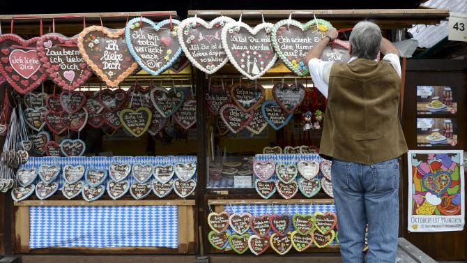 A vendor adjusts his display of gingerbread prior to the opening day of the 181st Oktoberfest in Munich