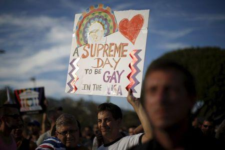 Steve Ledoux, 55, and his husband Mark Becktold, 53, who married in 2008, celebrate at a rally in West Hollywood