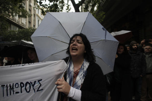 A tax accountant shouts slogans during a protest against, a new tax law at the entrance of Finance Ministry in central Athens, on Friday, Mar. 7, 2014. About 2,000 people participated in the protest.