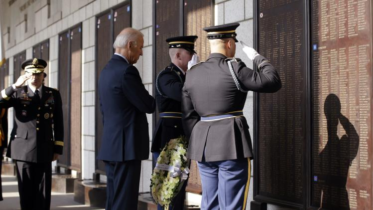 U.S. Vice President Biden salutes after laying a wreath in front of the list of names of U.S. soldiers who died during the Korean War, at the Korean War Memorial Museum in Seoul