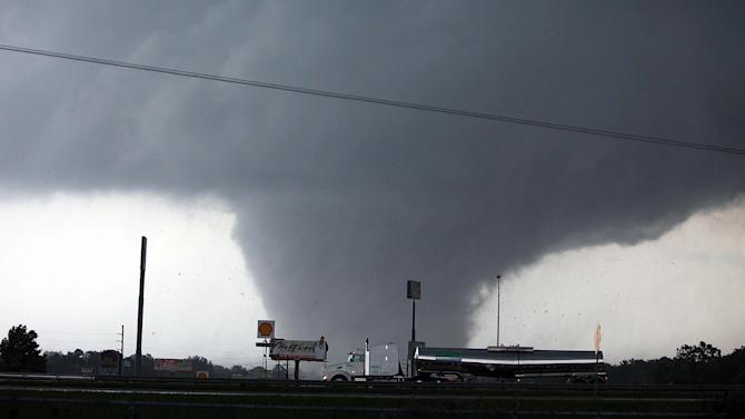 In this April 27, 2011 file photo, a tornado moves through Tuscaloosa, Ala. The Tuscaloosa News won a Pulitzer Prize in Breaking News Reporting for their coverage of the April 27, 2011 tornado that destroyed much of Tuscaloosa. A year after the Pulitzer judges found no entry worthy of the prize for breaking news, The Tuscaloosa News of Alabama won the award for coverage of a deadly tornado. (AP Photo/The Tuscaloosa News, Dusty Compton, File)